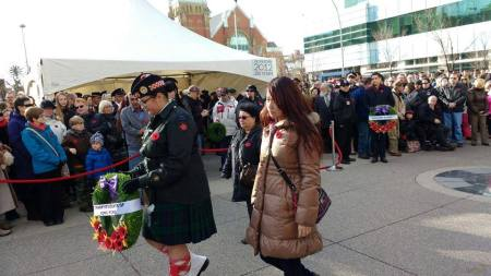 //Presenting our wreaths!// Photo and text credit: Terry